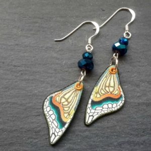 Butterfly wing style drop earrings in yellow tones